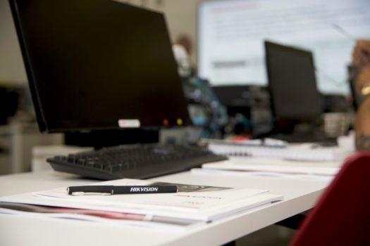 hikvision-computer-and-pen-e1490089788116-64c740576493188b08ada1dde3b04f9ce71066b2