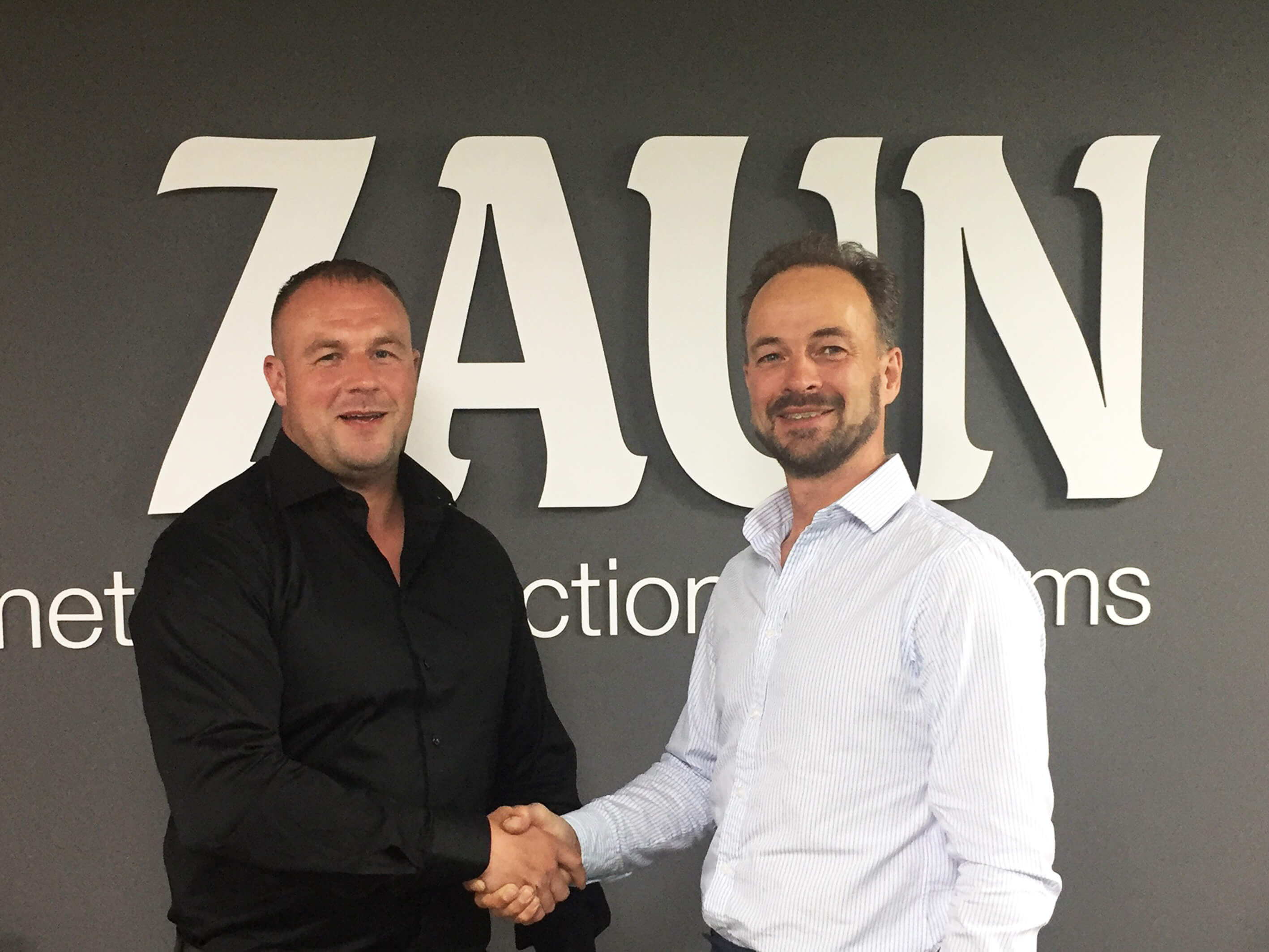 Mike Fellows of Fastline (left) and Alastair Henman of Zaun shake on creating a'combined powerhouse'.