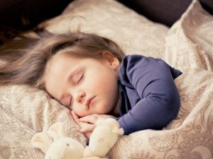 sleeping-child-bed-e1540915843977-6064720aed871d4d944c3aefbe191572adfa6a69